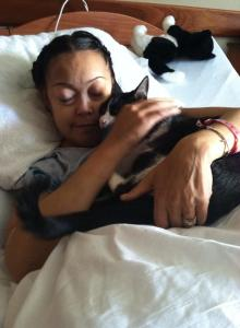 Donna enjoying a visit from her beloved cat Max.